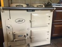 AGA cooker, in cream. Very old model but in perfect working order. Oil fired.