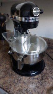 Kitchen Aid Edition 5 stand up mixer with juicing attachment.
