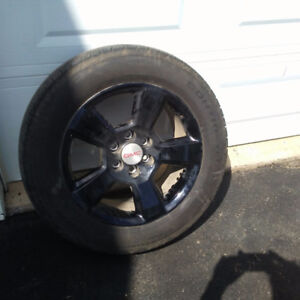 4 Black rims and tires