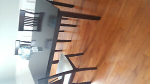 Dining room table and a few chairs