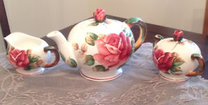 Lovely teapot with matching cream and sugar