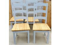 Four rustic shabby chic ladder-back dining chairs.