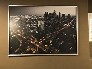 Large cityscape art piece. Metal frame