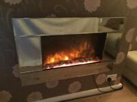 Electric wall mounted mirrored pebble fire