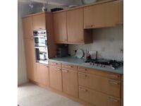 Fully fitted kitchen in beech