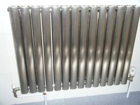 Designer Radiator. Brushed Stainless Steel, Length 33 inches Height 24 inches. Nearly New