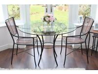 Glass topped table with four matching chairs