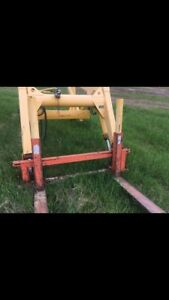 Front end loader tractor attachment