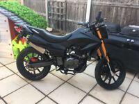 Matt black Keeway TXM 125 2015 model motorbike