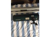 Orion StarBlast 4.5 EQ reflector telescope with lenses including barlow