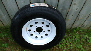 Brand new spare tire and rim for sale