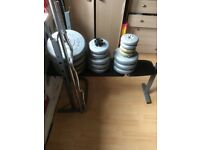 Weight bench with a mixture of 16 weights
