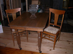 Small antique  wood table with 2 upholstered chairs.