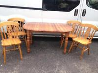 Solid extendable pine table with 4 chairs.