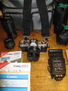 Canon AE-1 SLR with 3 Lenses and Case.  Excellent Condition.