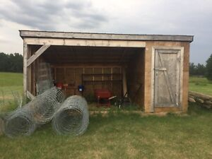 Horse shelter with attached tack shelter