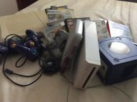 Bundle of consuls, games and controllers.
