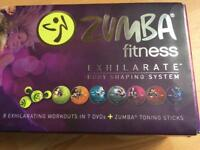 Brand New Zumba Fitness DVDs with dumbells