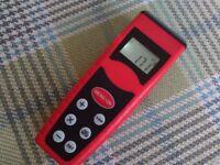 Ultrasonic tape measure/estimator with laser.