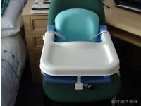 Blue baby booster seat with tray