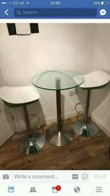 High adjustable stools and glass table