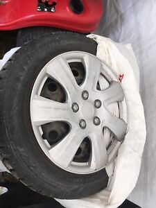 4 used Studded Winter Tires and Rims