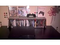 Sony PS3 with 2 pads and 40 games