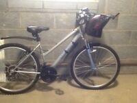 Ladies bicycle,as new with helmet,basket, bell and bikelock