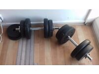 2 Dumbbells plus 22.5 kg in weights