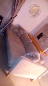 Ikea karlstad sofabed with custom made Soferia beige velour covers.