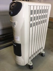 Electric oil filled room heater