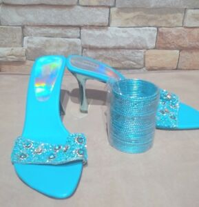 Brand new size 7 blue shoes with gorgeous silver heels.