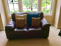 Distressed brown leather sofa