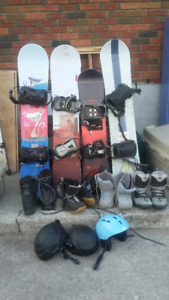 4 snowboards boots bindings and helmets