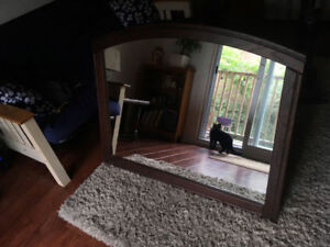 Large dark wood framed mirror