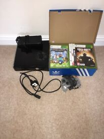 Xbox 360 console with 18 games and see through controller..excellent condition but un boxed