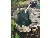 Pond liner and rockery effect waterfall