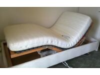 Electric Adjustable single bed with massage function. Excellent condition.