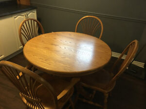 Solid oak table and chairs, seats 6 $300 obo