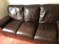 Two 3-seater leather sofas