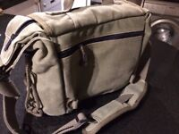 Used camera bag with multiple compartments and cross body strap