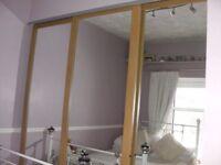 3 sliding oak/mirrored wardrobe doors