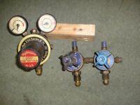 Two Oxygen Regulators And A Hydrogen Regulator