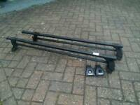 Thule roof cross bars for cars with side rails.