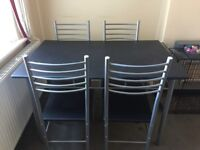 Black colour new table with 4 chairs
