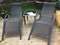2 matching sun loungers and table