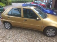 Citroen Saxo in Great car gold and Automatic and in nice condition. Slight ding in boot .