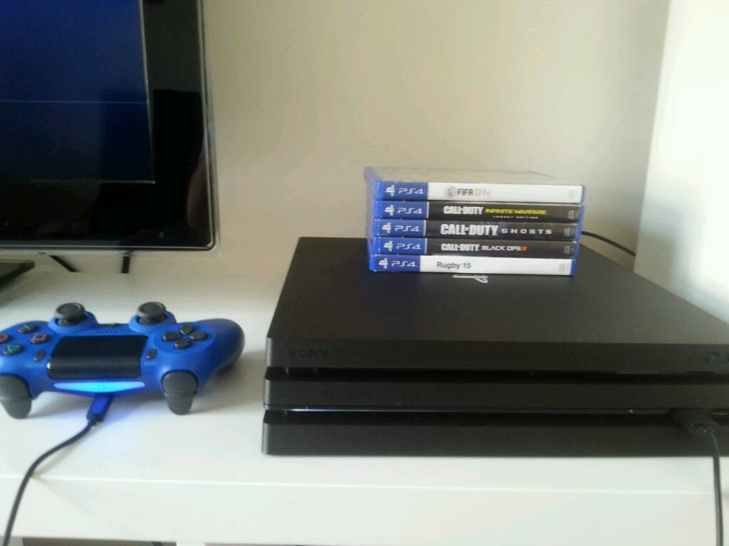 Ps4 pro with 5 games sale or swap