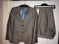 Nearly new grey boys suit age 7-8