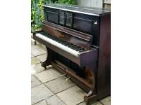 A Brown Upright Piano